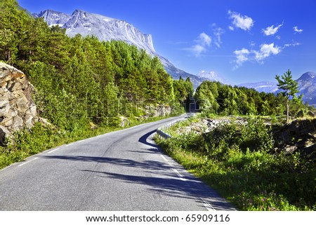 Road passing among mountains - stock photo
