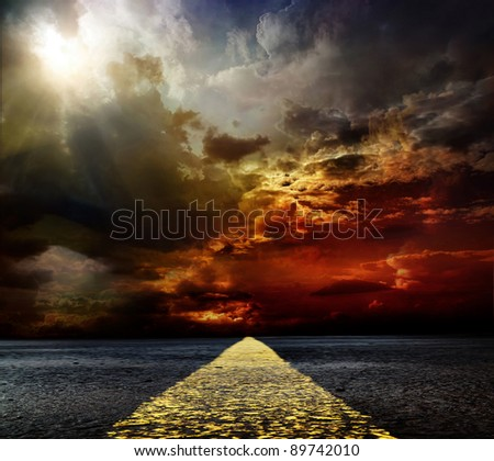 road paved with stormy sky - stock photo