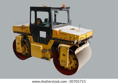 road roller under the grey background - stock photo