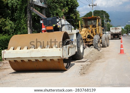 Road rollers during asphalt compaction works - stock photo