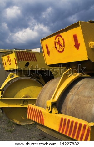 road-rollers under the lowering sky - stock photo