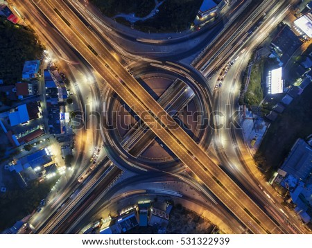 Road roundabout large Aerial The road beautiful at Night , Bird Eye View in bangkok , top view , Bangkok , Thailand .