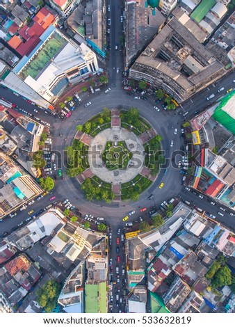Road roundabout with car lots in the city in Thailand.Sixth Street intersection is beautiful.city scape. Light evening.Aerial view. transportation.