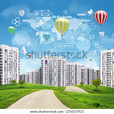 Road running through green hills with a few trees. High-rise buildings with a few air-baloons above as backdrop. Charts, hexagons and other virtual items in sky - stock photo
