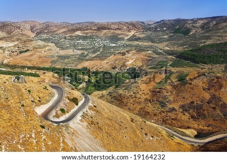 Road serpentine in mountains of Israel on border with Jordan - stock photo