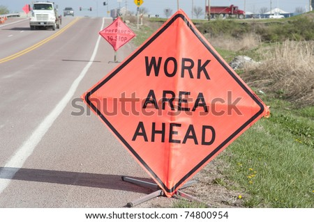 Road-side signs warning motorists of work ahead - stock photo