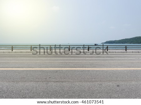 Road side view on sea background.