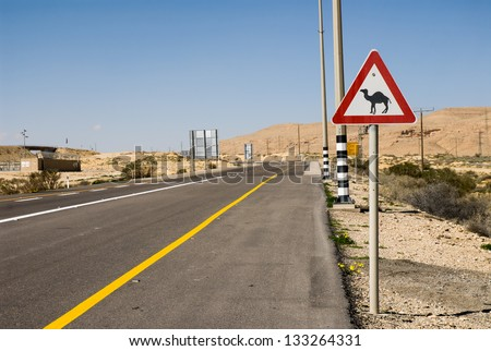 Road sign about loose camels on a way through the Negev desert,Israel