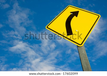 road sign against a blue sky with clipping path. - stock photo