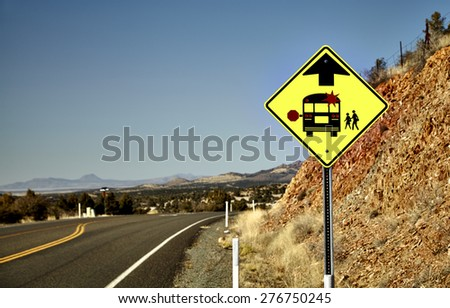 Road Sign alerting motorists of approaching school bus stop - stock photo