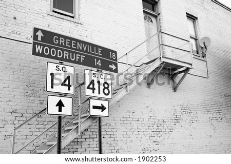 Road Sign and Building - stock photo