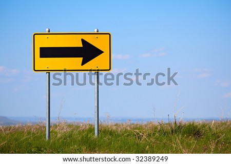 road sign at the end of a rural road - right turn only one way - stock photo