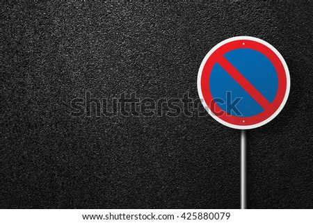 Road sign circular shape. Behind the signs one can see a smooth asphalt road. The texture of the tarmac, top view. - stock photo