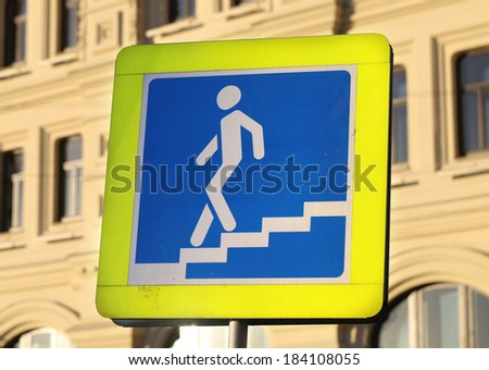 Road sign crosswalk on the building background - stock photo