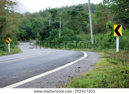Road sign, Curve warning  - stock photo