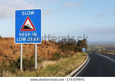 Road sign depicting a 20% steep hill decent at Blue Bank on The North Yorkshire Moors, UK  - stock photo