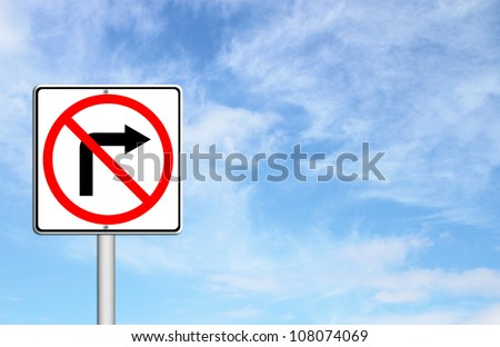 Road sign don't turn right over blue sky blank for text