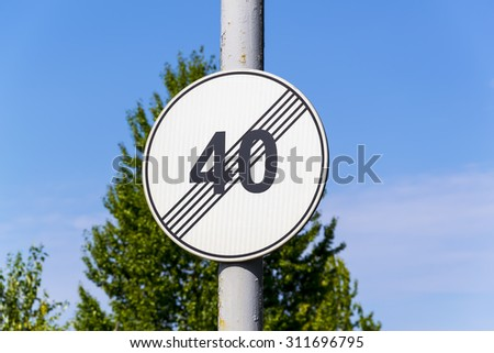 road sign end speed limit 40 - stock photo