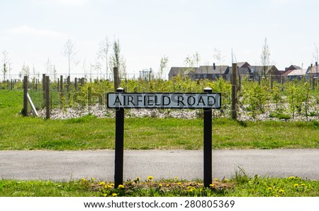 Road sign for Airfield Road in rural Suffolk, England - stock photo