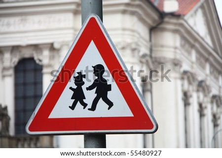 Road sign for the security of children near a school. - stock photo