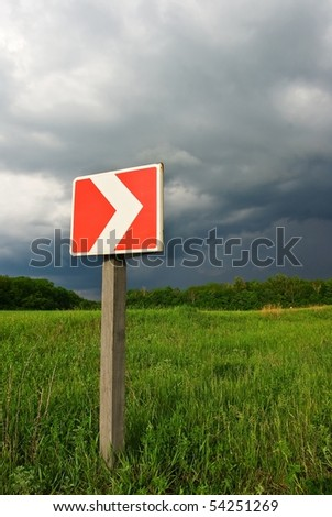 road sign in a grass
