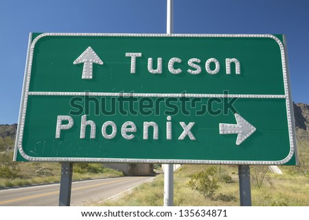 Road sign in Arizona directing traffic to Tucson and Phoenix, AZ - stock photo