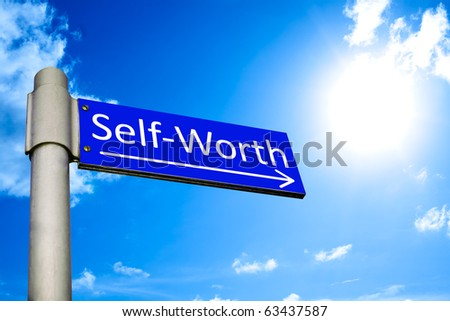 Road sign in front of a blue sky showing the way to self-worth - stock photo