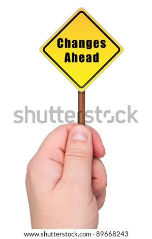 Road sign in hand labeled changes ahead. Isolated on white background. - stock photo
