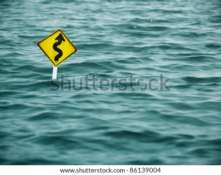 road sign in the severe flood - stock photo