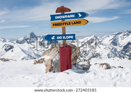 Road Sign In the Snow. Winter Scenic in the French Alps, Les 2 Alpes - stock photo