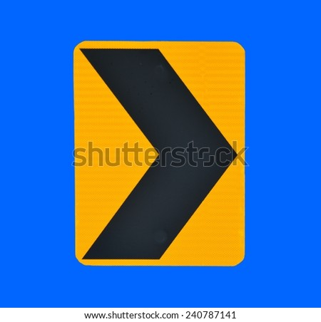 road sign indicating direction on curved road - stock photo