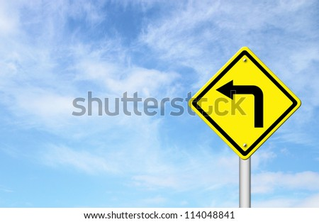 Road Sign - Left Turn Warning with blue sky blank for text - stock photo