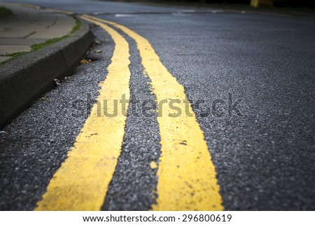 Road sign next to pavement on a street. - stock photo