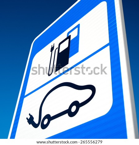 Road sign of electric car battery recharge station over deep blue sky background. - stock photo