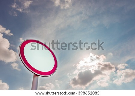 Road sign on a blue sky background - stock photo