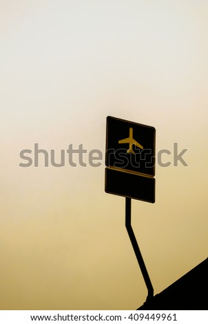 Road sign on a vintage sky background with an aeroplane sign - stock photo