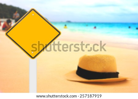 road sign on beautiful beach background.  - stock photo