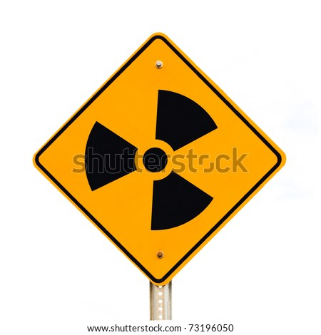 Road sign on pole warning of nuclear radiation isolated on white background. - stock photo
