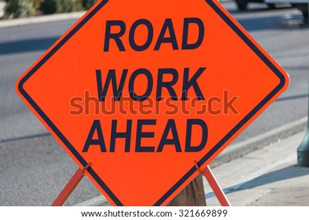 Road sign on the street - stock photo