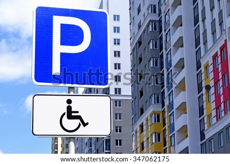 """Road sign """"Parking for disabled """" - stock photo"""