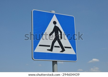 Road sign, pedestrian across road