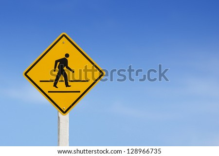 road sign pedestrian sign on blue sky - stock photo