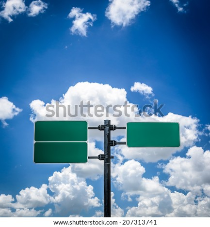 road  sign pole and blue sky with clouds - stock photo