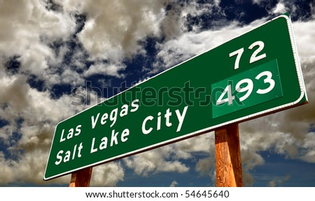 Road Sign's Contrasting Cities - stock photo