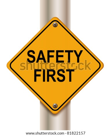 Road sign 'safety first' on white background - stock photo