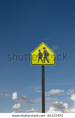 road sign - school crossing against blue sky - stock photo