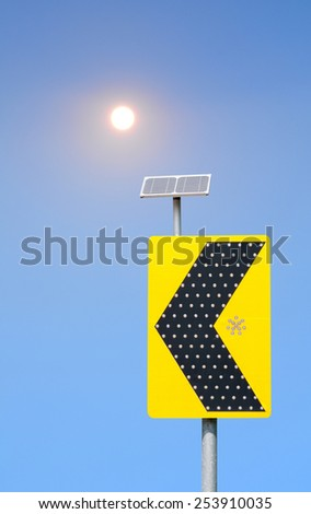 Road sign solar cell and  sun on blue sky background - stock photo