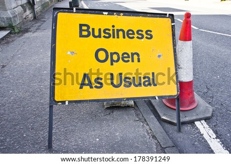 Road sign stating business open as usual during period of road works
