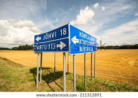 road sign, summer landscape - stock photo