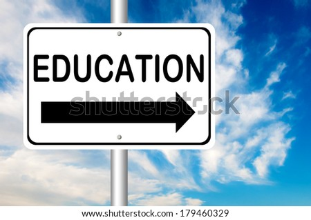 Road sign to education - stock photo